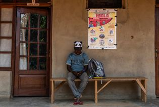 A young man waits outside a private clinic in Beni on February 27, 2019, with an ...