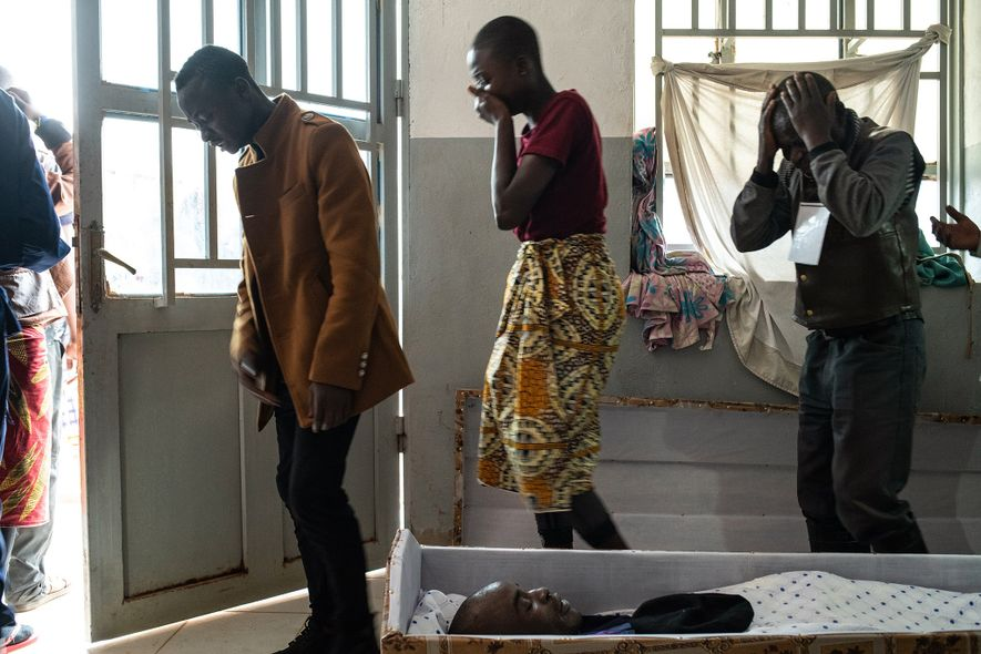 Family and friends view the body of police officer Tabu Amuli Emmanuel in the Matanda Hospital ...