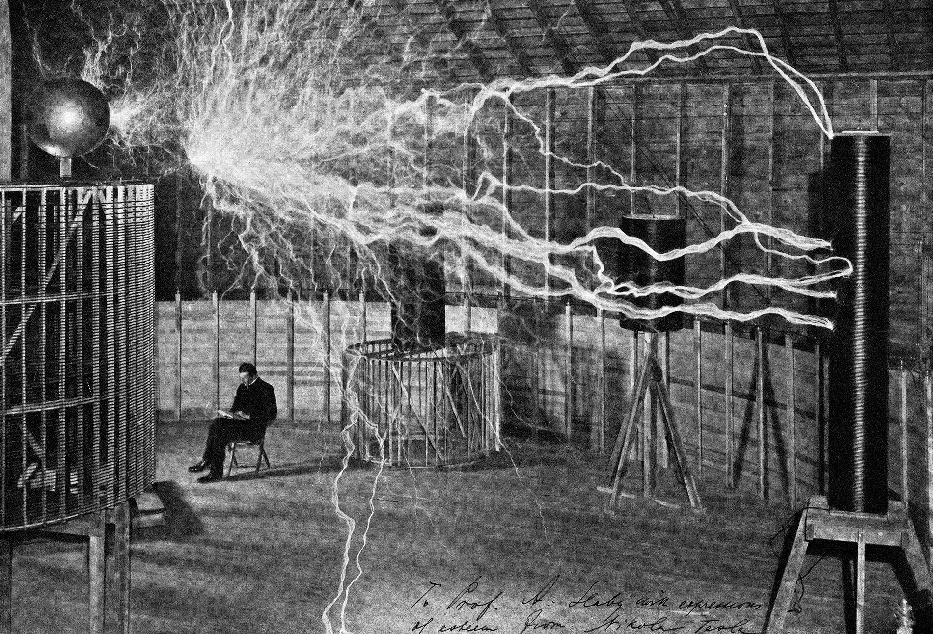 Nikola Tesla calmly takes notes while a man-made electrical storm erupts overhead in his laboratory in ...