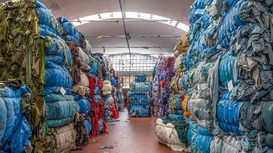 At this Prato, Italy, facility, bundles of rags and discarded textiles will be processed and used ...