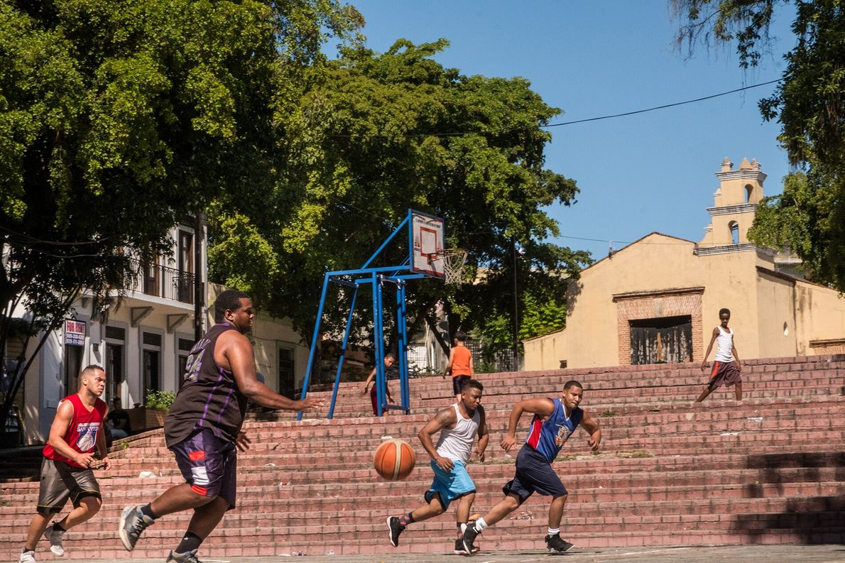 Locals play basketball in Plaza de San Antón, among stairs that lead up to the 16th-century ...