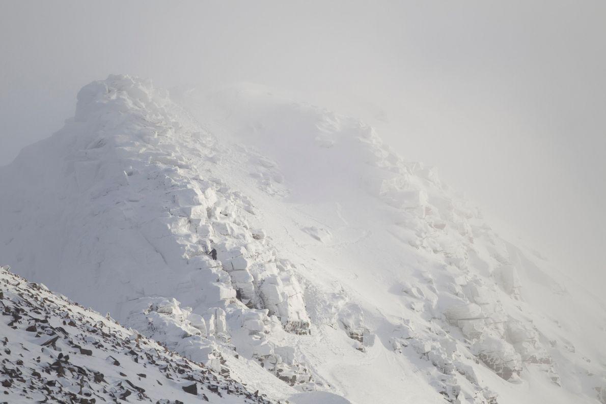 A climber negotiates steep ground on the cliffs of Coire an Lochan, near Cairn Gorm mountain. ...