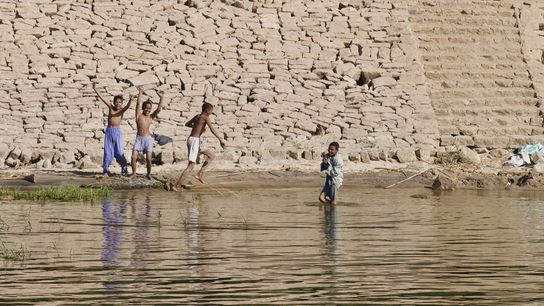 Village kids playing on the banks of the Nile.