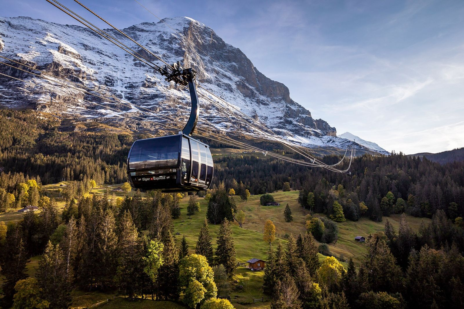 The new Eiger Express speeds visitors from the village of Grindelwald to a 7,637-foot station on ...