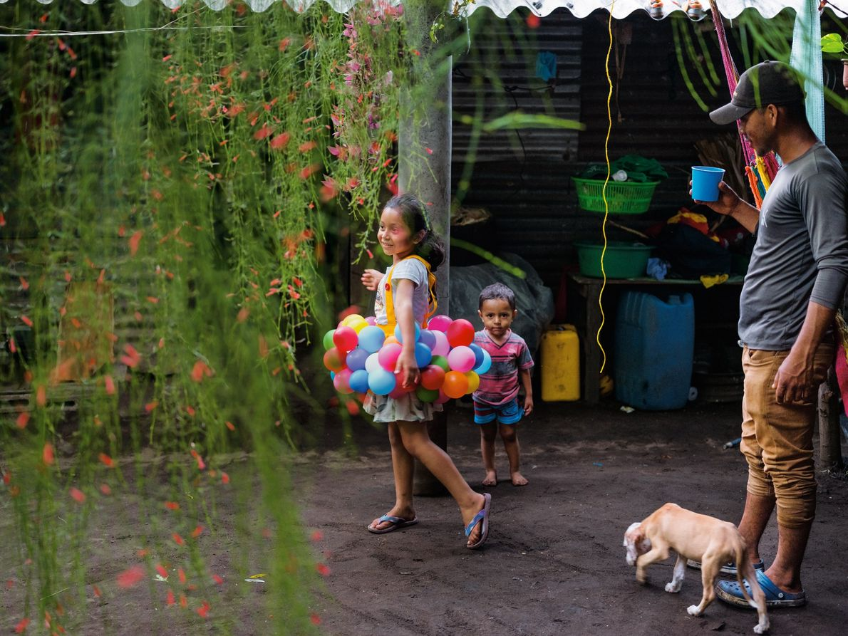 Salvadoran fisherman Arnovis Guidos Portillo watches his daughter and son in their home in Usulután department. ...