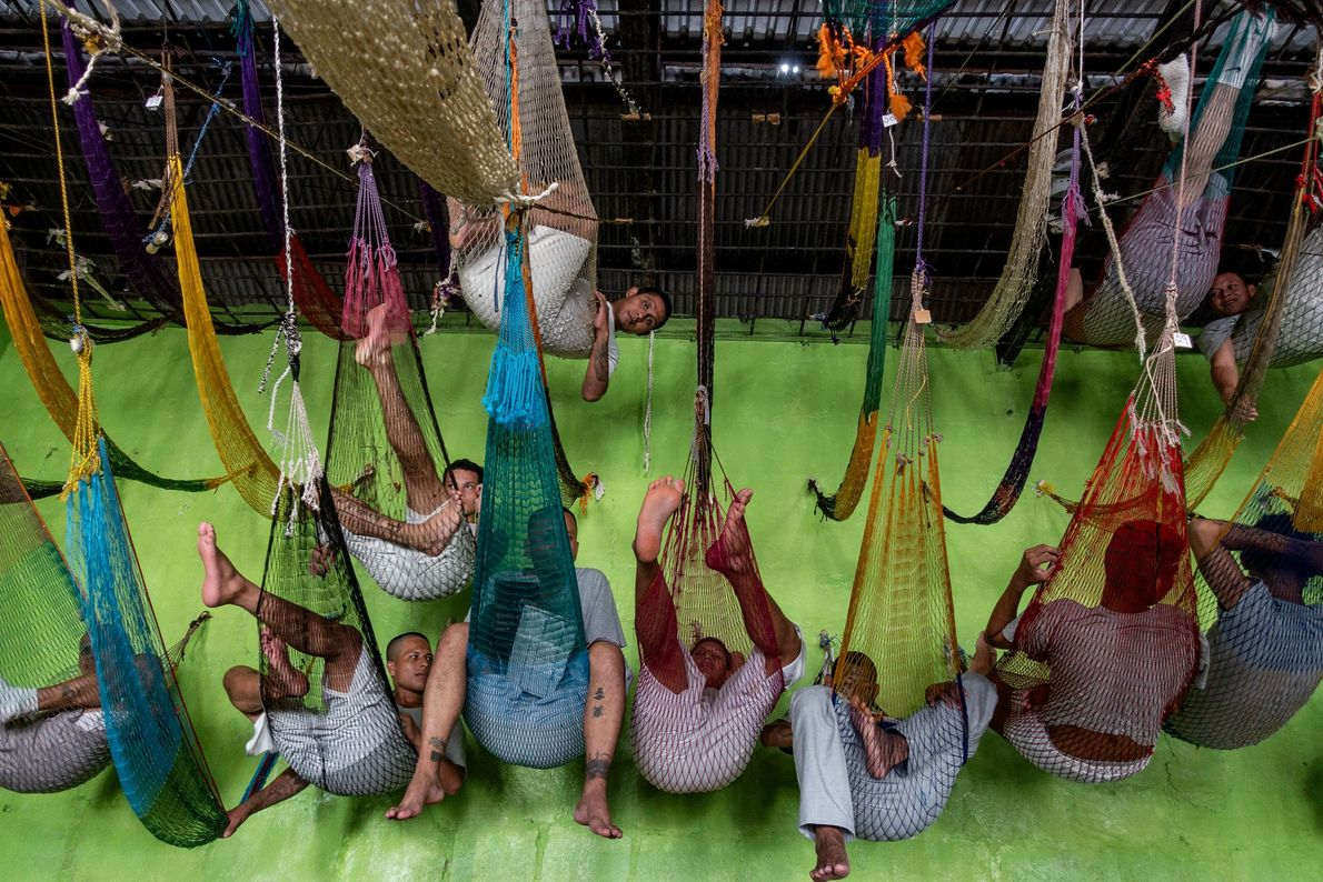 Former gang members hang from their hammocks inside the San Francisco Gotera prison in Morazán department.