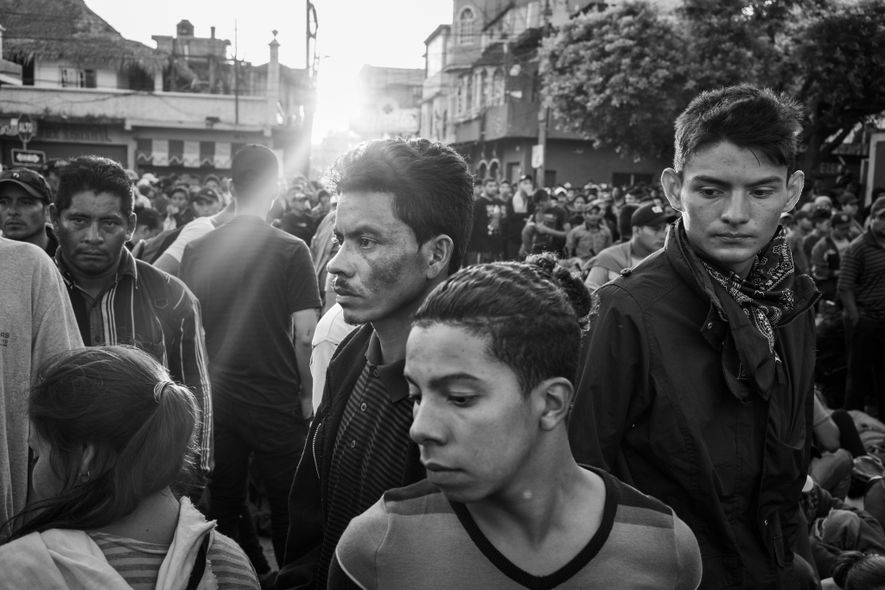 Starting at 5 a.m., migrants line up at the border in Guatemala waiting for officials to ...