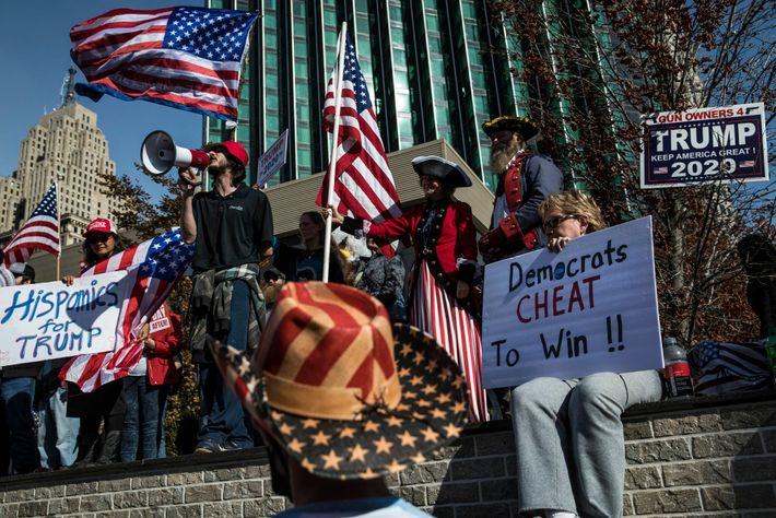 In Detroit, Trump supporters protest the validity of the ongoing vote count outside the city's TCF ...