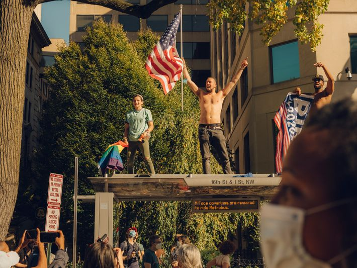 Four days after Election Day, revellers at Black Lives Matter Plaza in Washington, D.C., react to ...