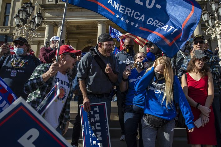 On the steps of the Michigan State Capitol in Lansing, Trump supporters shout at Biden supporters ...