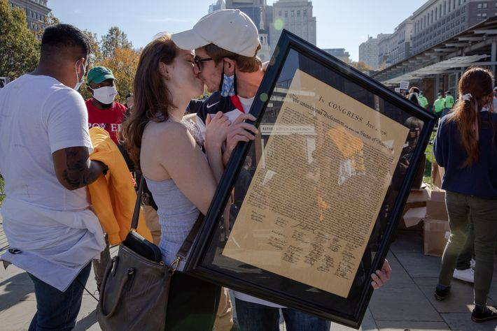 Cooper Sherwin and Joan Taylor, who both canvassed for Joe Biden in Pennsylvania, kiss as Sherwin ...