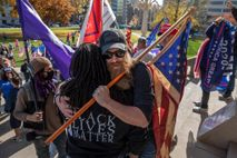 An embrace the nation needs: On the steps of Michigan's State Capitol in Lansing, amid loud ...