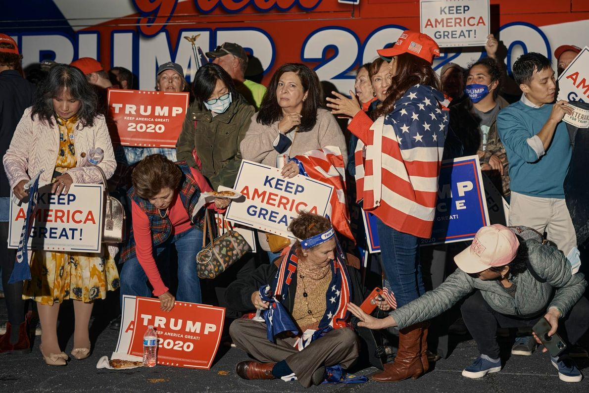As they wait to learn the result of the U.S. presidential election, Trump supporters attend a ...