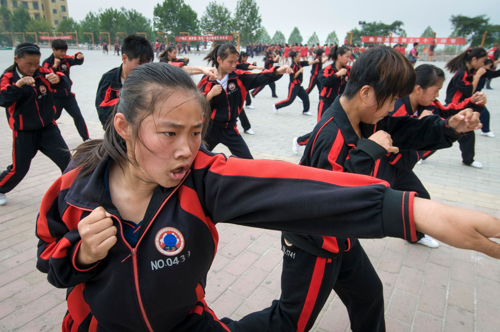 Students train in kung fu at the Songshan Shaolin Temple Wuseng Tuan Training Centre in Henan Province, China, ...