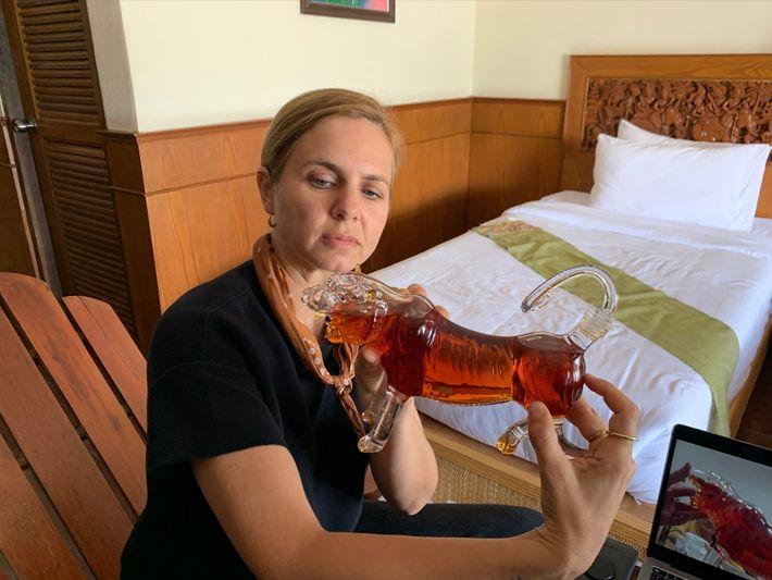 On the Thailand-Laos border, Van Zeller holds a bottle of suspected tiger bone wine, prized – ...