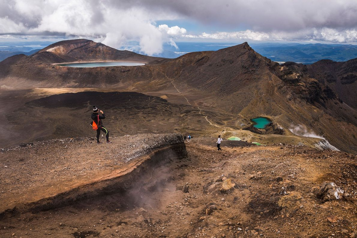 """With river valleys, fiery red craters, twin emerald lakes, and the """"Mount Doom"""" volcano featured in …"""