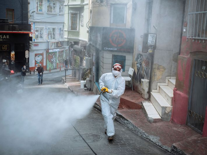 ON THE FRONT LINES IN A GLOBAL CRISIS  04.14, Istanbul, Turkey A city employee disinfects a street ...