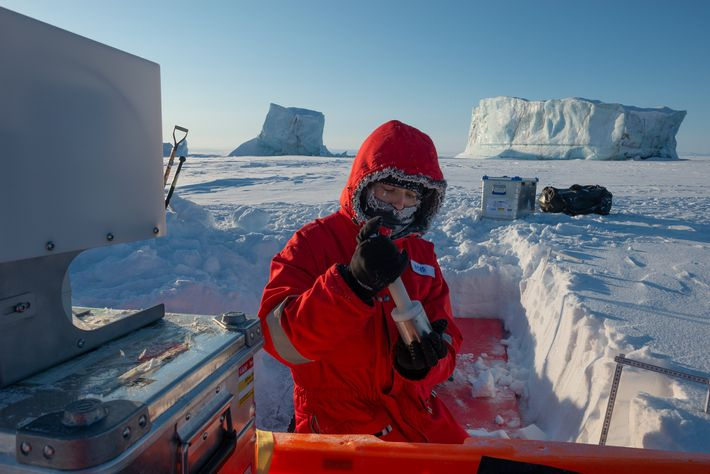 Research assistant Nora Fried uses a handheld IceCube, an instrument that measures the specific surface area ...