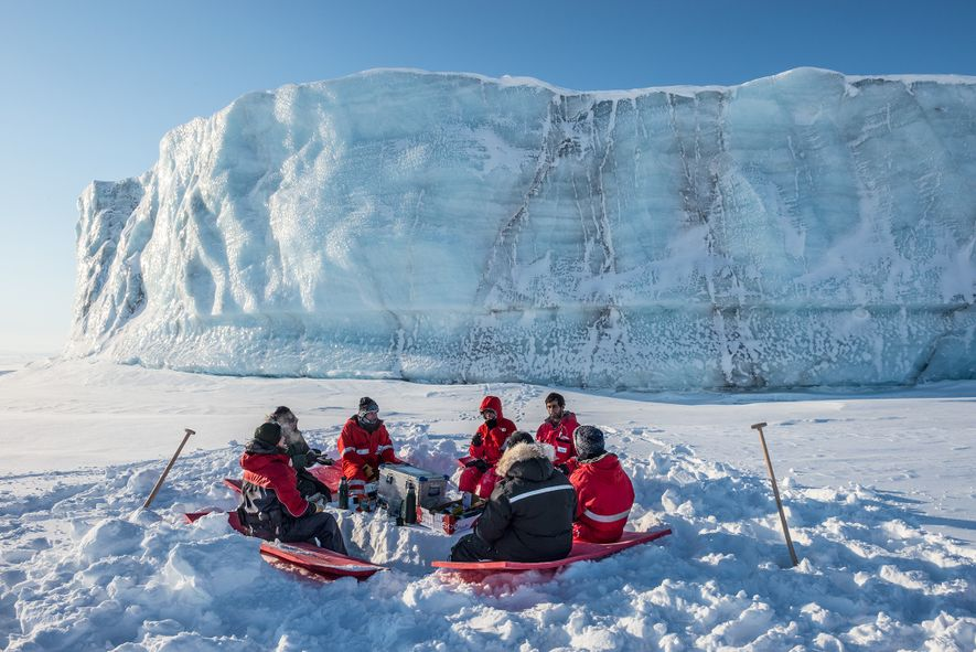 Lunch next to an iceberg on the sea ice is a hurried affair with temperatures below ...
