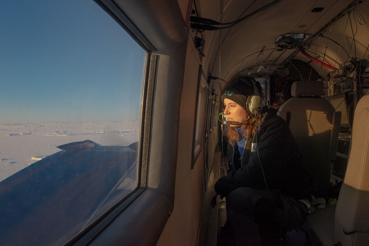 Engineer Cristina Sans looks out the window of the Polar 5 research aircraft during a flight ...