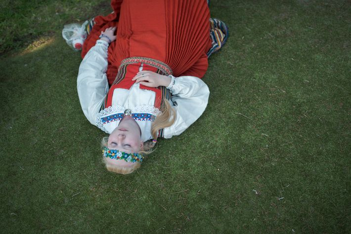 A singer rests during the 26th Song Festival (Laulupidu) 2014 in Tallin, Estonia.