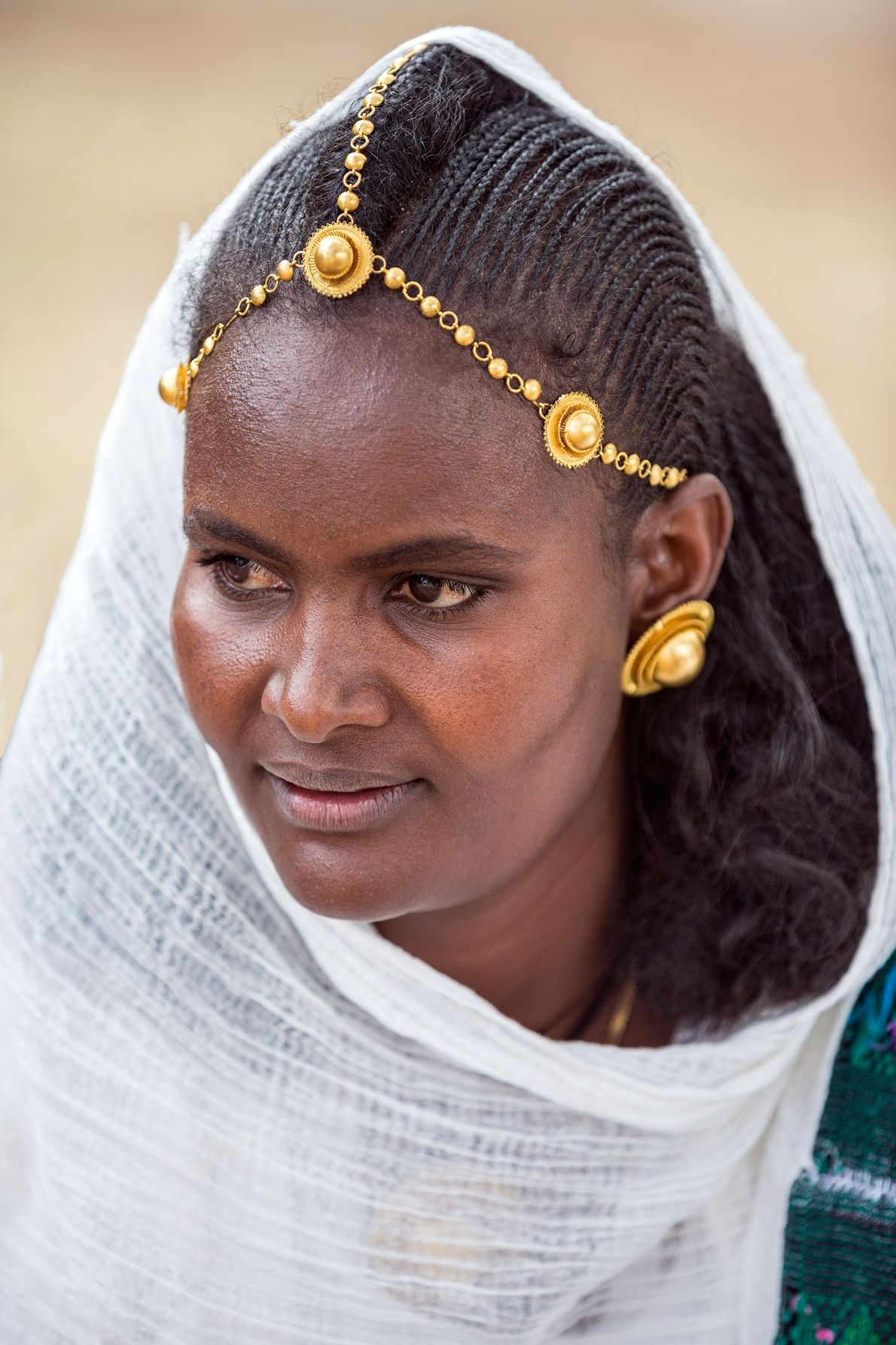 A young Ethiopian woman with distinctive hairstyle and jewellery.
