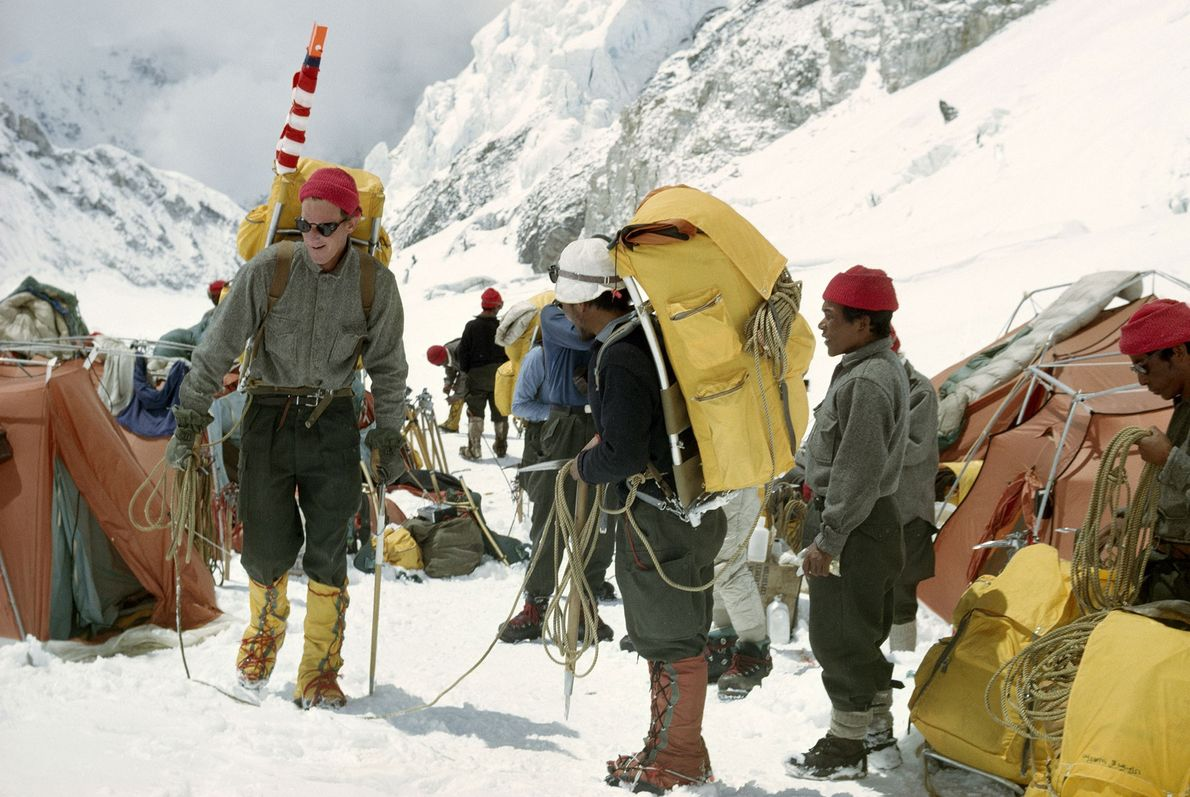 A group of climbers leave camp and begin their Everest summit attempt.