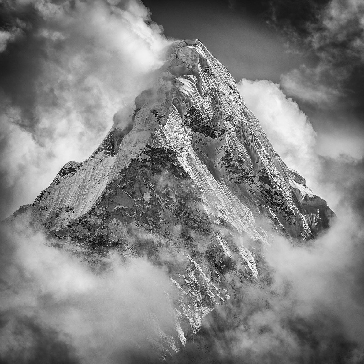 Clouds circle the peak of Mount Everest, the world's tallest mountain at 29,035 feet.