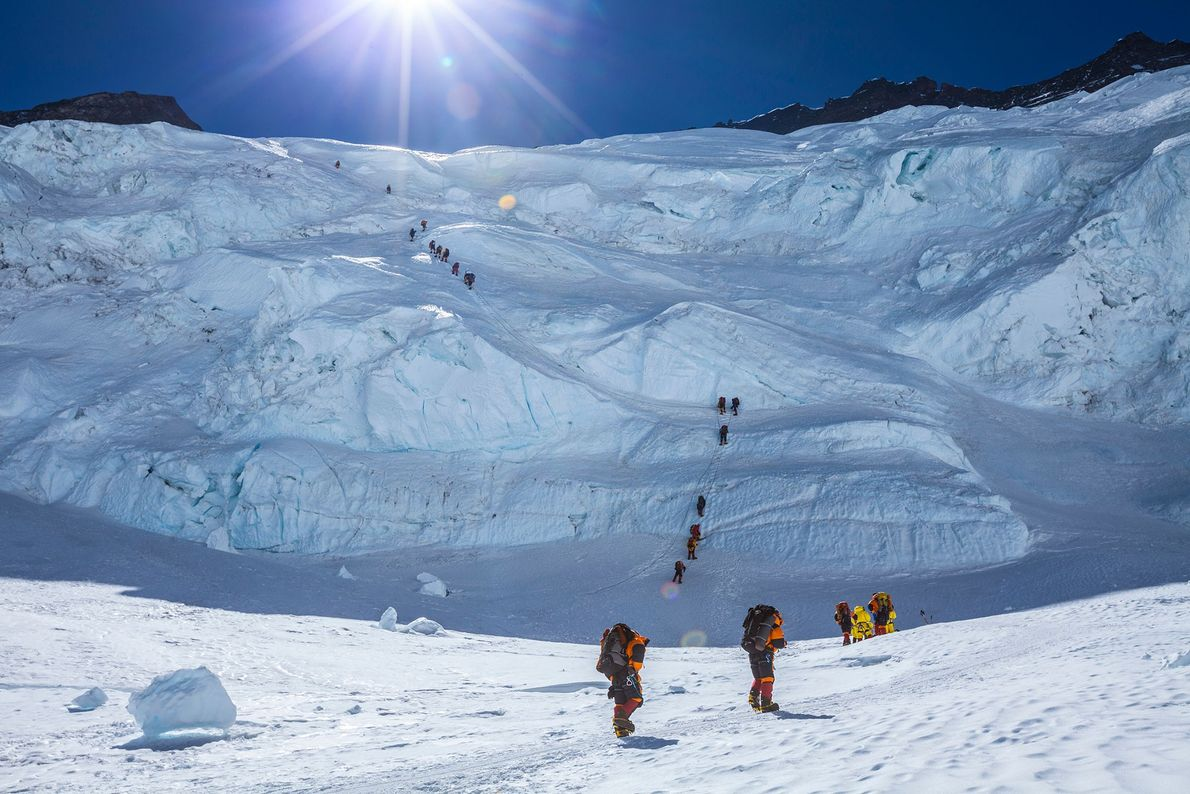 A group of climbers ascend fixed ropes up the Lhotse face to the South Col, a ...