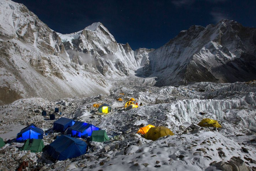 Tents pepper the ground of Everest Base Camp, tucked into the mountainside under the towering Khumbu ...