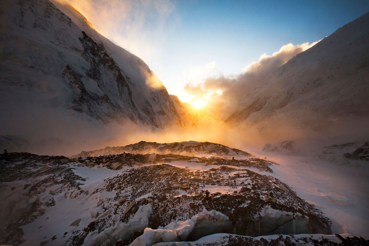 Light dusts Mount Everest's West Shoulder and Nuptse, a nearby peak just southwest of Mount Everest, ...