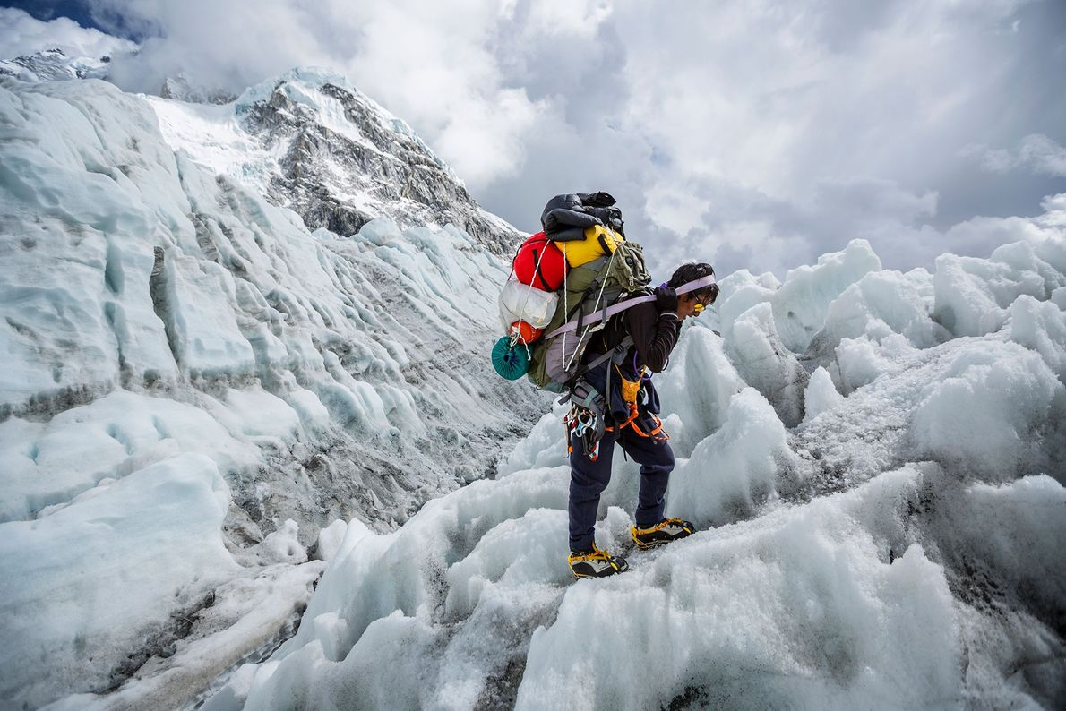 After gathering the remaining pieces of gear at Camp 2, a sherpa descends the Khumbu Ice ...