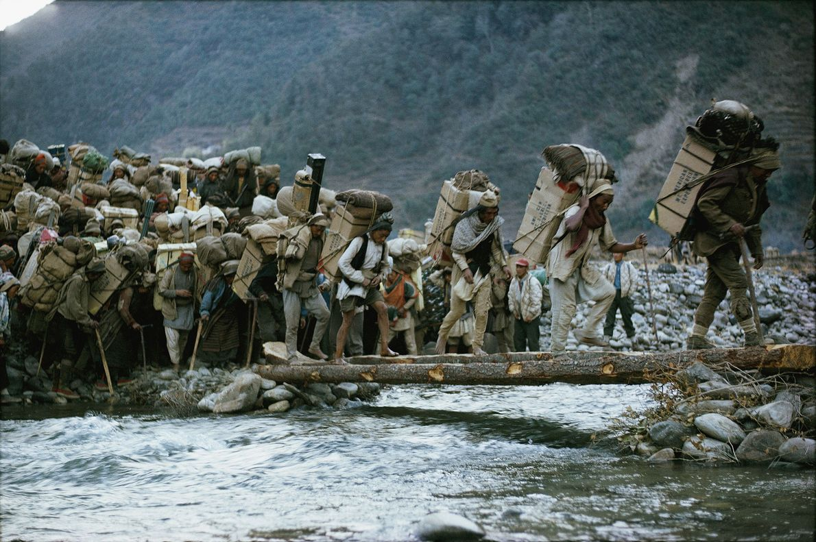 Porters carry supplies to Everest Base Camp as part of the 1963 American Mount Everest Expedition. ...