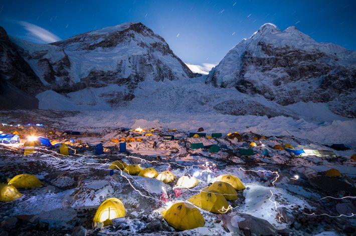 Headlamps shine through the night at Khumbu Basecamp on Mount Everest.