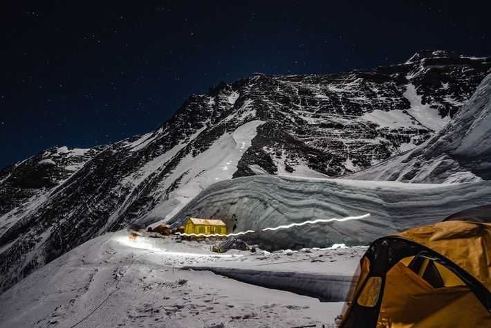 "Climbers' headlamps form a light trail up the lower flank of Everest. ""People in the West ..."