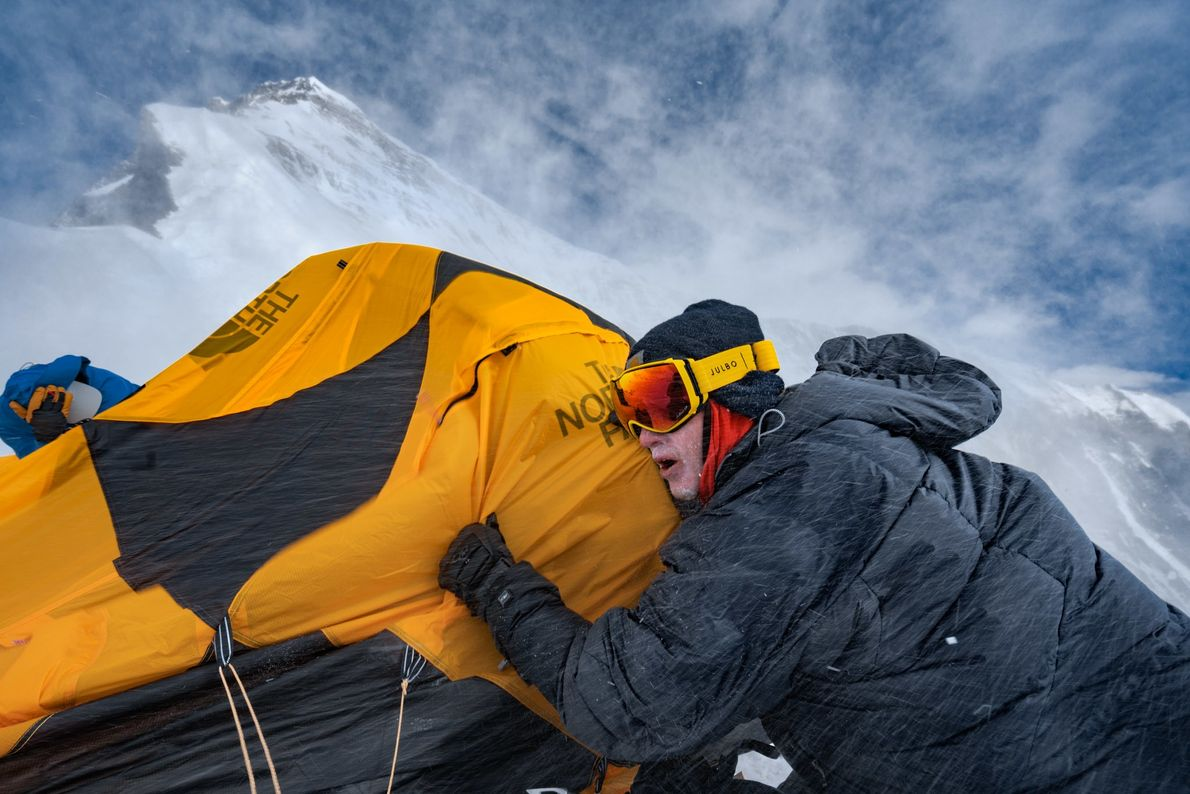 Blasted by hurricane-strength winds at 23,000 feet, Nick Kalisz clings to a broken tent after a ...