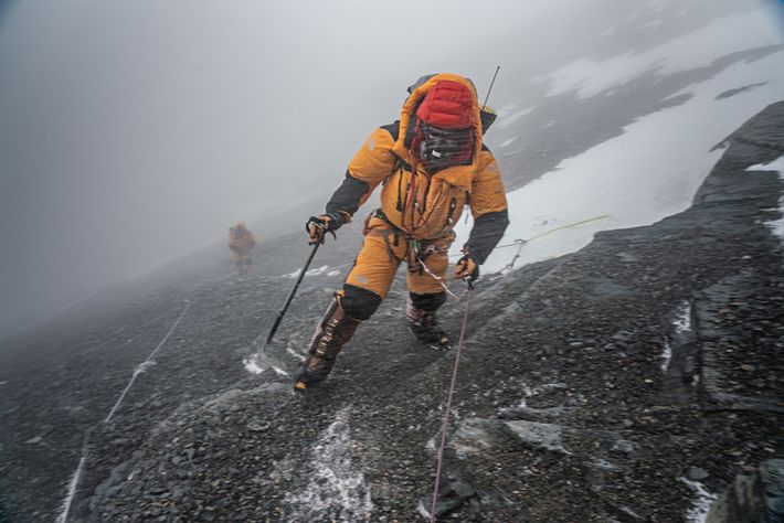 Jamie McGuinness, the team's guide and expedition leader, pushes through a snow squall to Camp III ...
