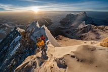 The sun illuminates the Tibetan plateau, shining its light on the northern flanks of Everest. The ...