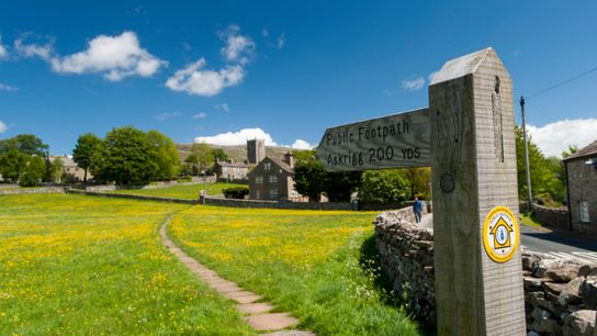 A footpath leading to Askrigg, Yorkshire. The UK has an extensive and well-documented footpath network stretching to ...