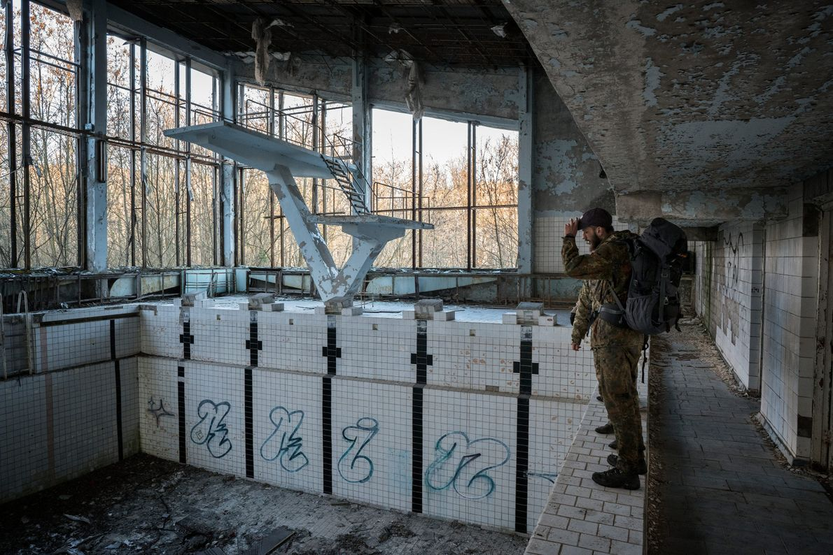 "Knyazev roams an abandoned pool in Pripyat. ""You feel like the last person on Earth,"" he ..."