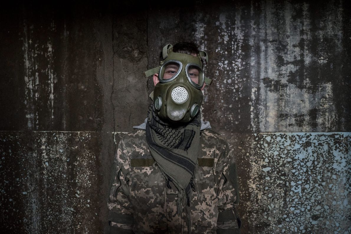 A stalker dons a mock gas mask.