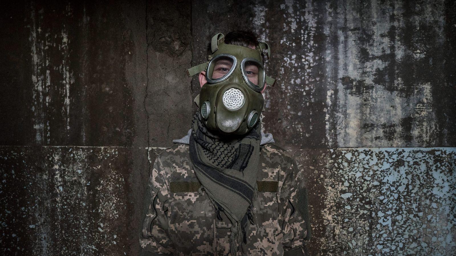 A stalker dons a mock gas mask.