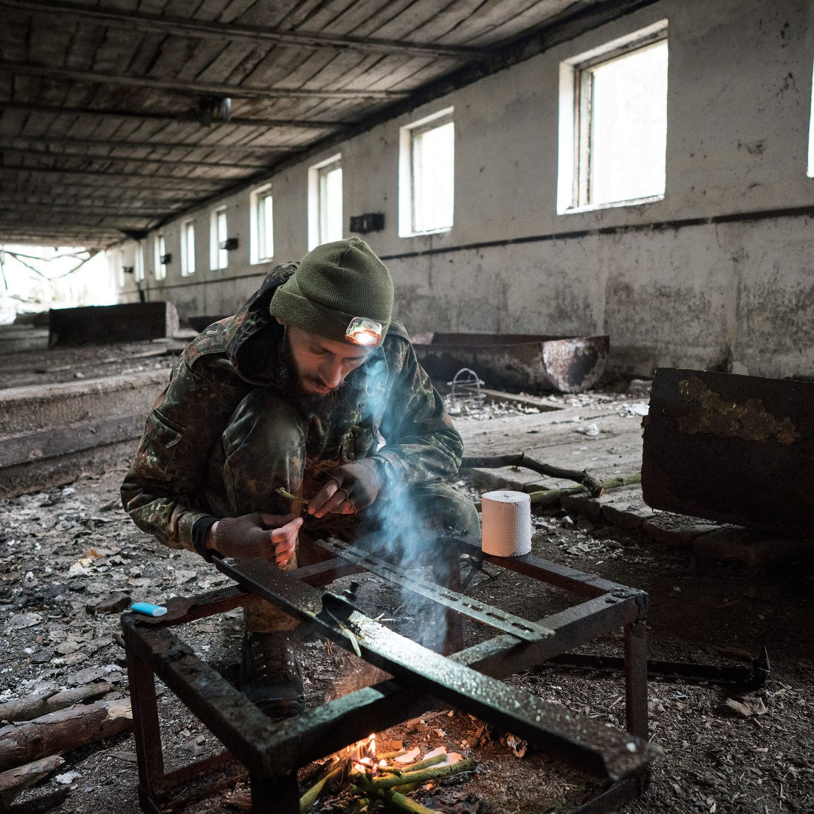 Knyazev lights a fire in an abadoned pig shed. He has made more than 50 trips ...