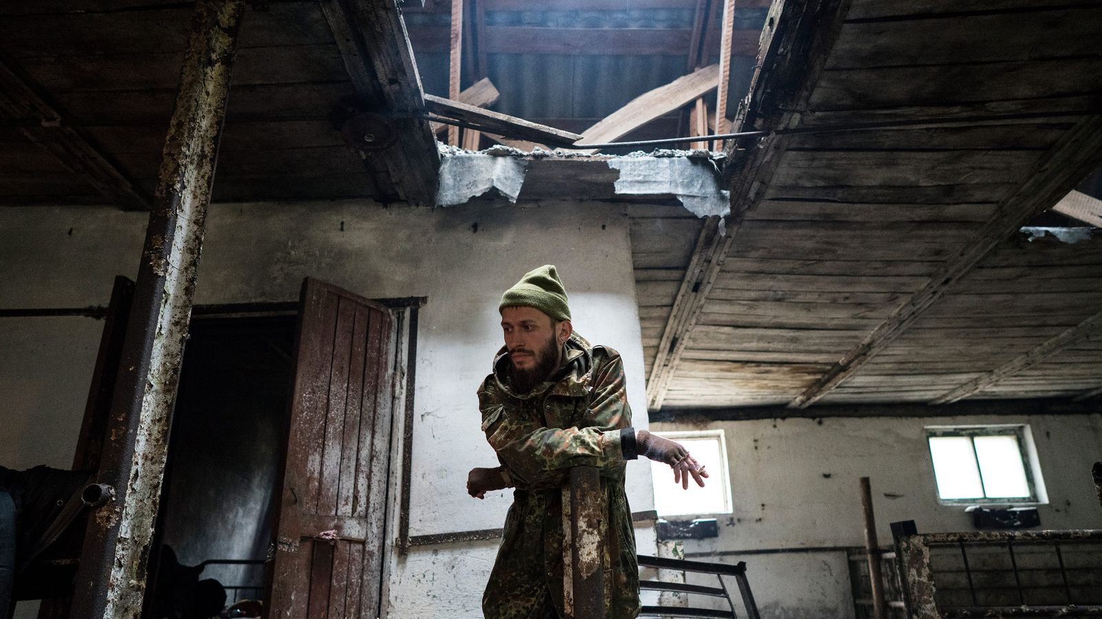 """Knyazev (nicknamed JimmSide), rests in an abandoned pig shed on the journey to Pripyat. """"I'm attracted ..."""