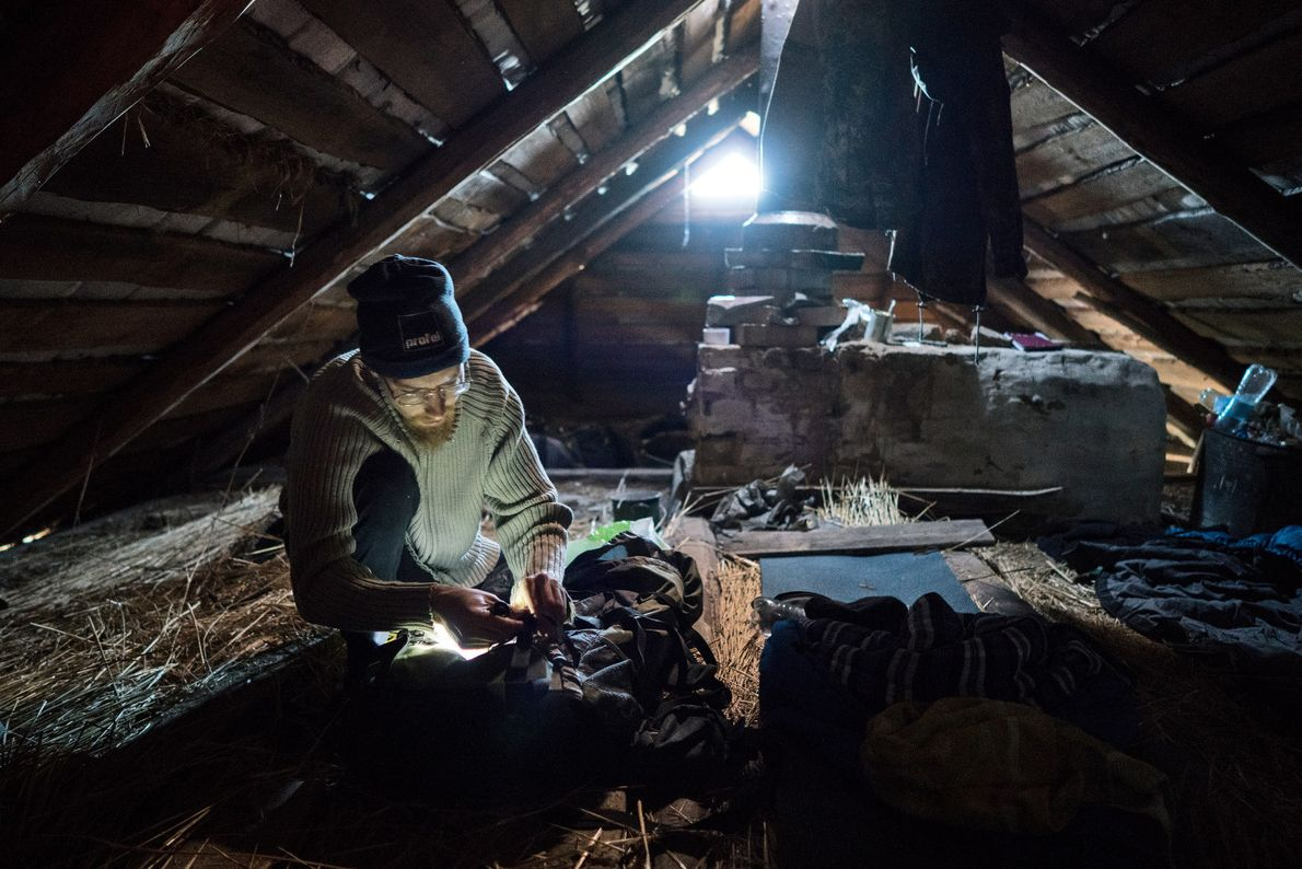 Sherekh prepares to sleep in an abandoned house in Rudnya Veresnya. Stalkers usually sleep in attics ...