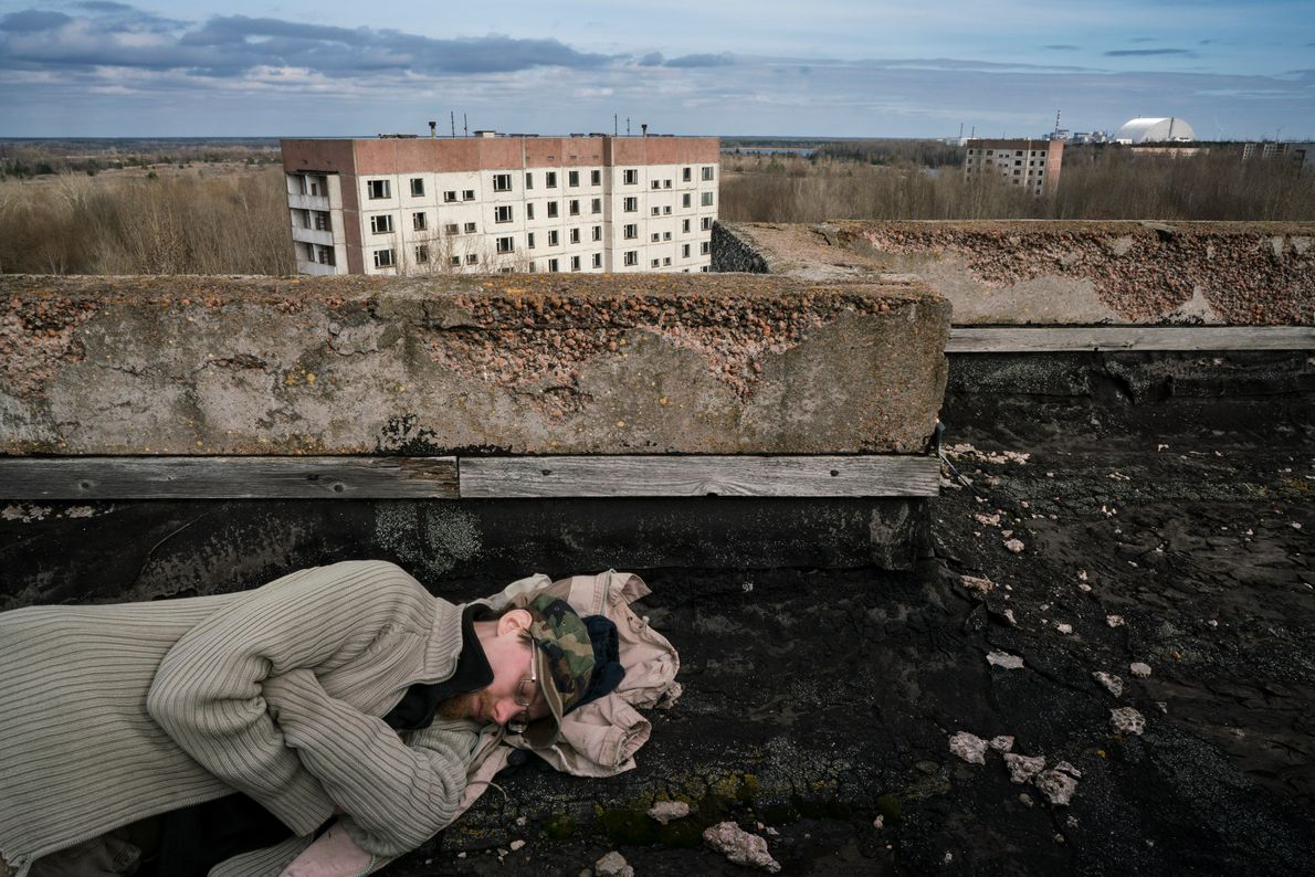 Sherekh (nicknamed Freeman) sleeps on the roof of a building less than two miles from reactor ...