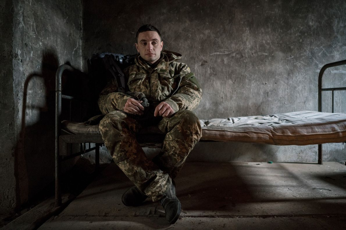 "Rudyavsky rests in a pig shed after a long trek through the woods. ""[In the zone] ..."