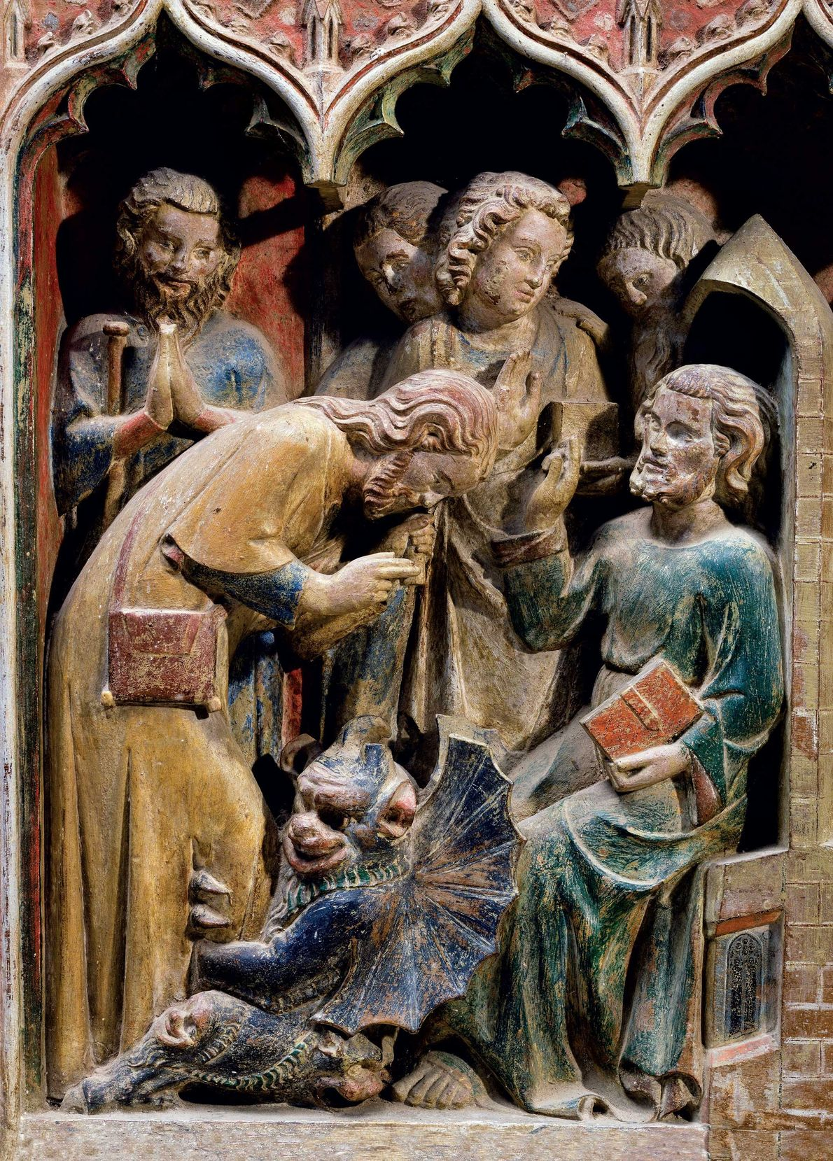 St. Theobald exorcises a possessed man in this 14th-century altarpiece of the Church of St. Thibault ...