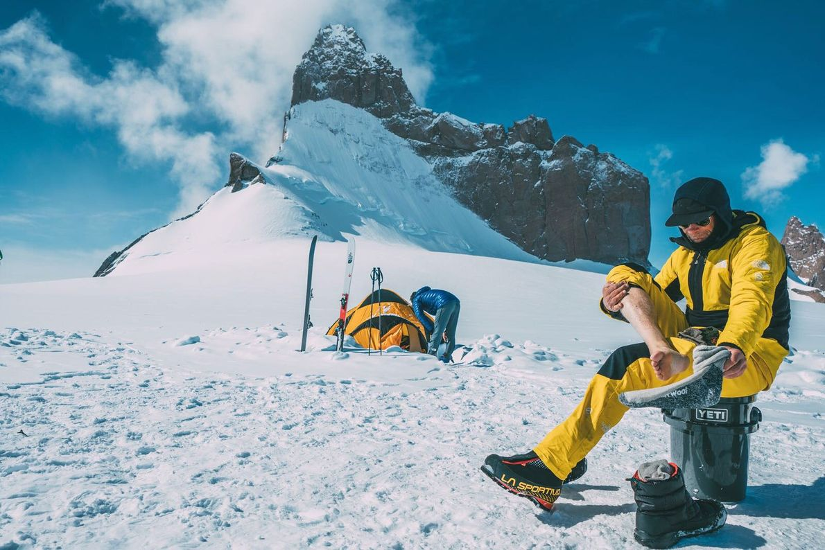 Conrad Anker boots up at base camp on the 'tongue' of Wolf's Jaw for another day ...