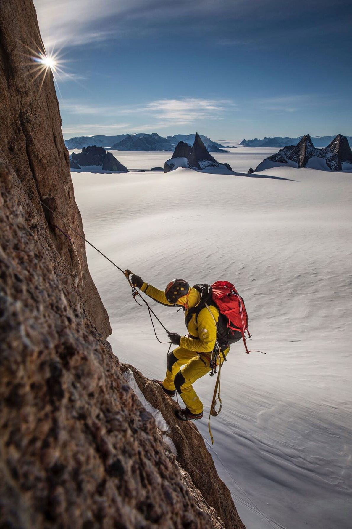 Conrad Anker uses mechanical ascenders to climb a fixed rope on Ulvetanna (2,931 metres; 9,616 feet). ...